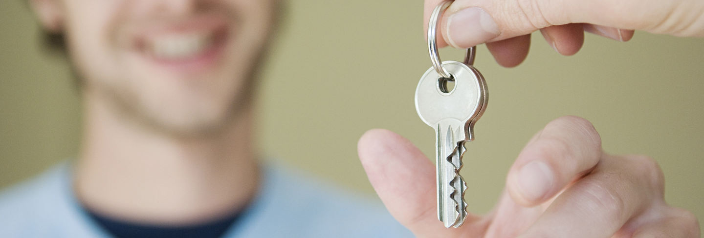 Man with key to home