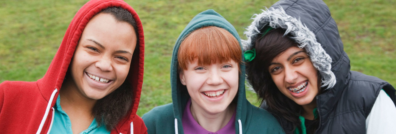 Smiling female teenagers