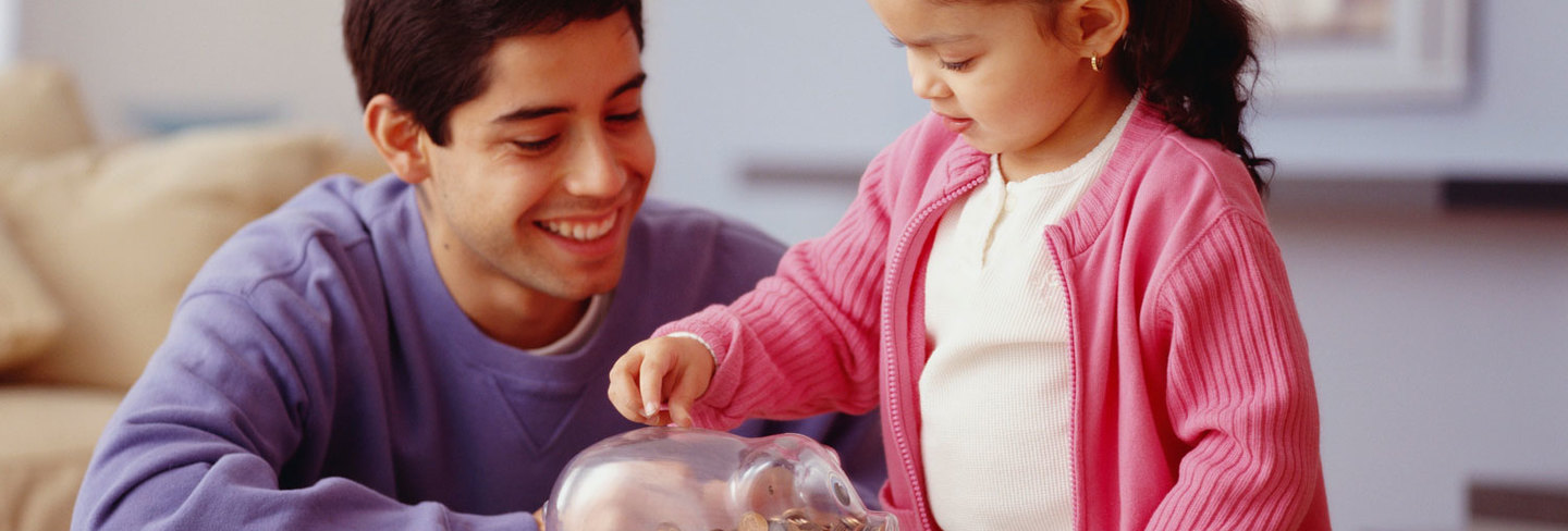 Father and daughter with piggybank