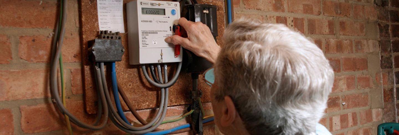 woman with prepay energy meter