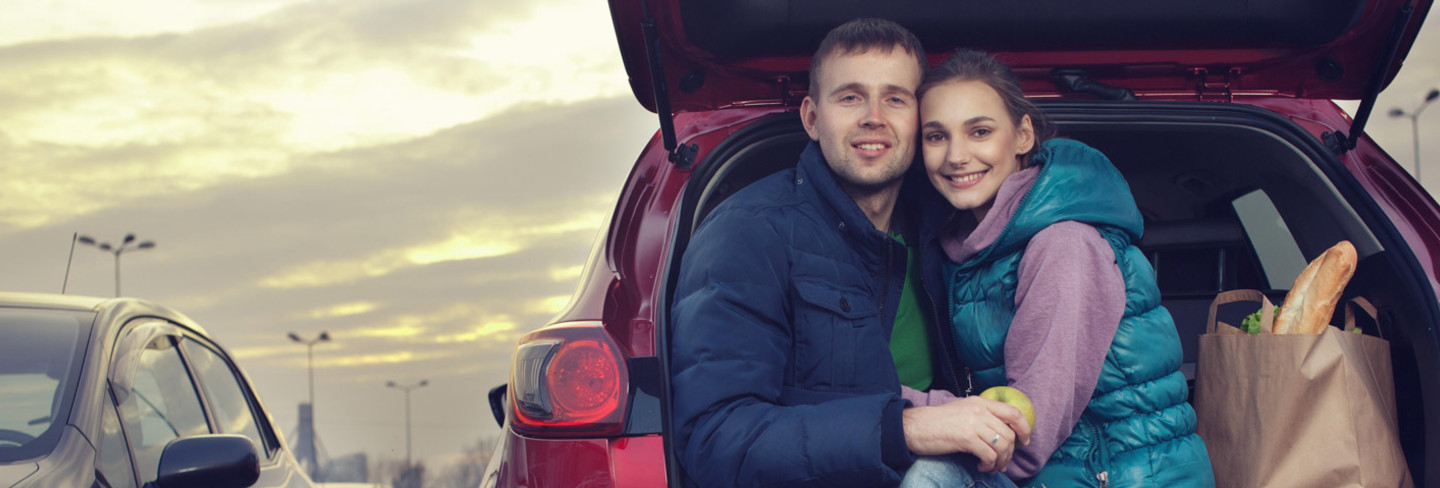 couple in car with shopping